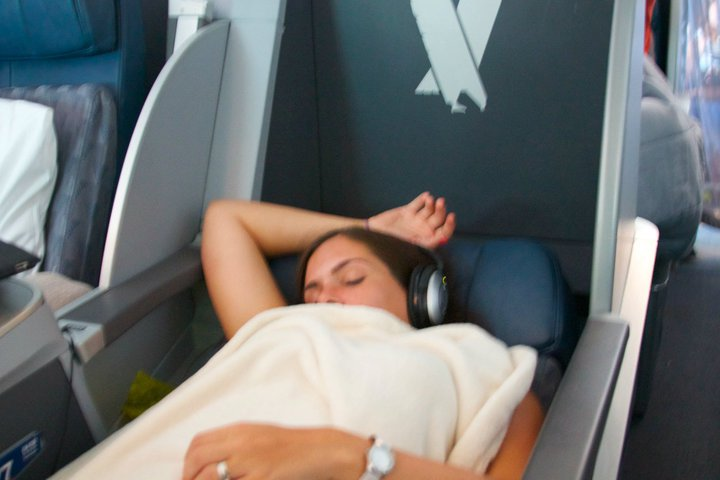 Flying economy vs. first class: the difference between just closing your eyes and actually sleeping.