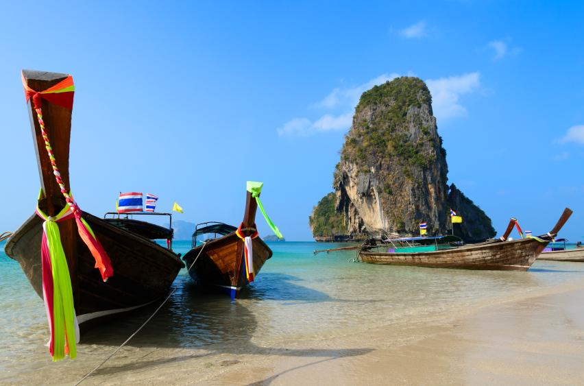 Longtail boats moored on Railay Beach, Krabi, Thailand.